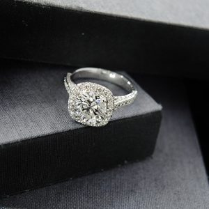 Close up diamond ring with gray and black background (selective focus)