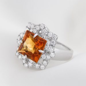 White Gold Ring With Citrine And Diamonds On Soft White Background