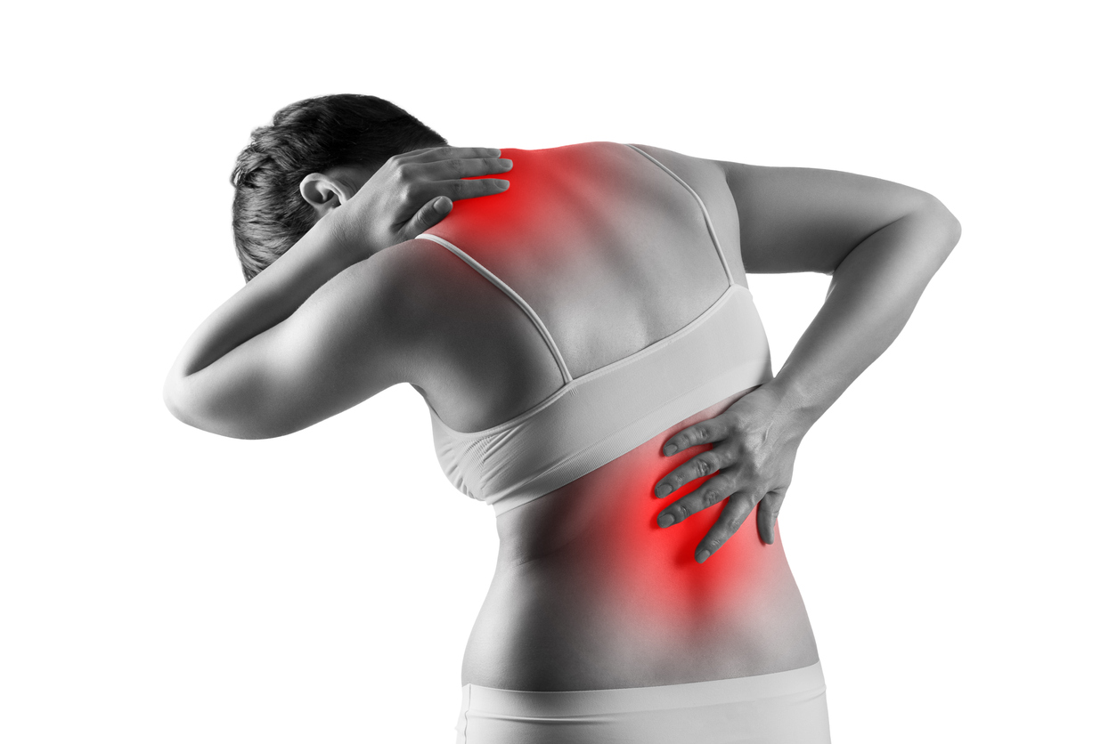 Pain in the female body, woman with back ache, sciatica and scoliosis isolated on white background, chiropractor treatment concept, painful area highlighted in red