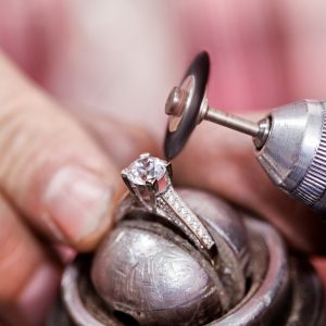 Jeweler polishing the diamond ring.