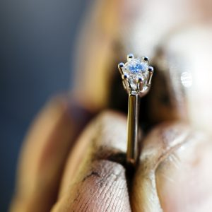 Ring held by jeweler after polishing it