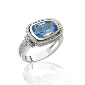 A nice greatest gift is the blue sapphire diamond ring isolated on shite