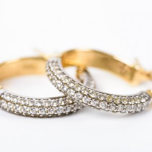 Gold Earrings With Diamonds On White