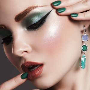 Beautiful woman with bright make-up and manicure