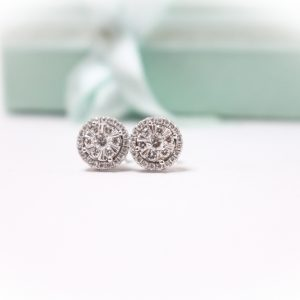 Elegant diamond earrings with gift box background. perfectly suitable for jewellery catalogue