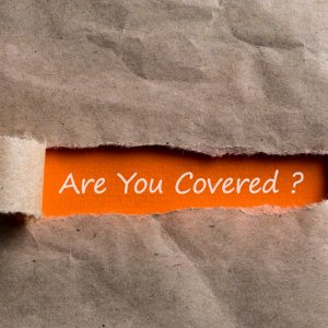Are you covered - question written on orange paper in brown envelope.